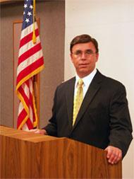 Dr. Mackles at Podium